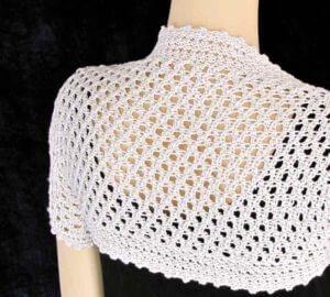 The Liebling Shrug is crocheted with both Tunisian and linked stitches.