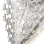 Silvery-white Frostyflakes Wrap, tied, photographed with light filled blurred framing
