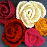 5 slip stitch roses of different colors and petal shapes