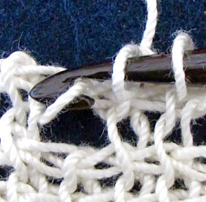 Extreme close up of a good quality crochet thread makes it look old and hairy.