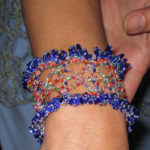 Doris wearing wire crochet replica of her Celebration Shawl design.