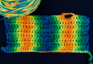 Rows of double crochets keep each color of a variegated yarn stacked in columns
