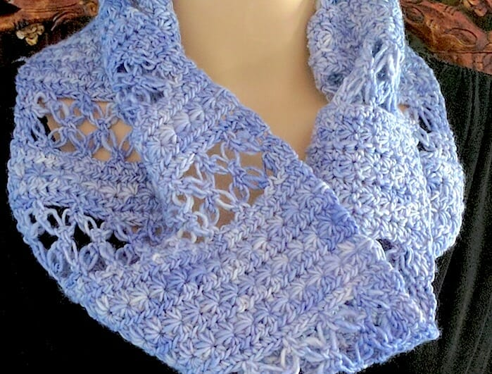 Close up of Lovelace Ring Scarf: bands of love knot mesh alternate with star stitch bands.