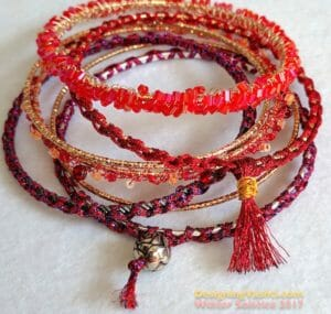 Stack of sparkling crocheted Solstice Bangles.