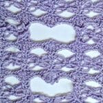 A fancy love knot pattern. Stitches have been selectively cut and unraveled.
