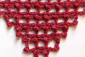 Picot filet stitch pattern started in the corner and increased at each row end using stitch equivalents.