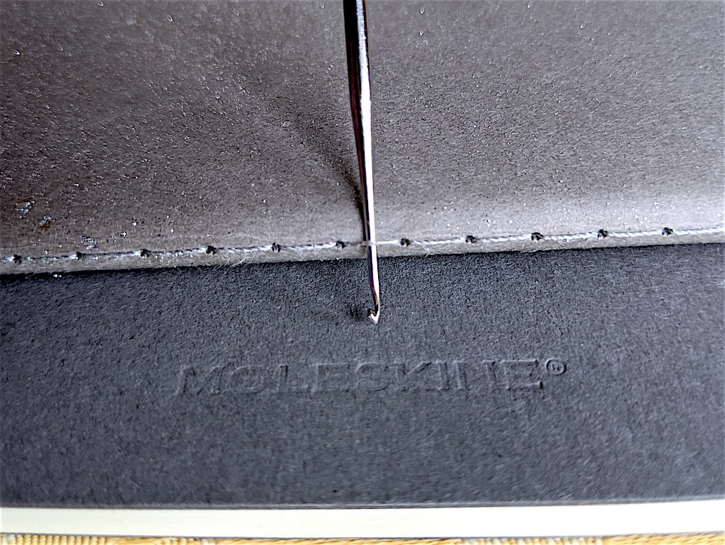 Moleskine crochet hook fit: find the steel hook size that fits in the seam stitch without stretching it.