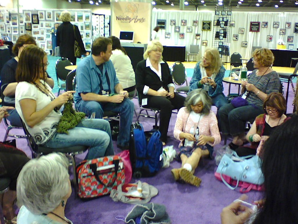 60s-style Crochet-In at 2007 TNNA industry show from front left around: Gwen Blakley Kinsler, Amy (yarn shop staff), Drew Emborsky, Candi Jensen, Doris Chan, Marty Miller, Jane Schwartz, Sheryl Means (Texas yarn shop owner)